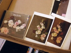 CD of New Order, Power Corruption and Lies plus poastcards of Roses by Henri Fantin Latour, from the National Gallery