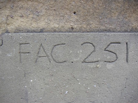FAC 251 One Charles Street in 2005; concrete block with FAC 251 inscription