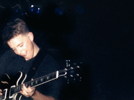 New Order live at FAC 51 The Hacienda 1983-85 - Bernard enjoys hitting the right chord!; [photo credit: Tim Sinclair]