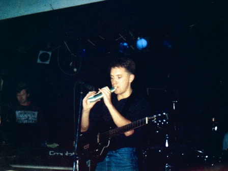 New Order live at FAC 51 The Hacienda 1983-85 - Bernard Sumner on melodica; [photo credit: Tim Sinclair]