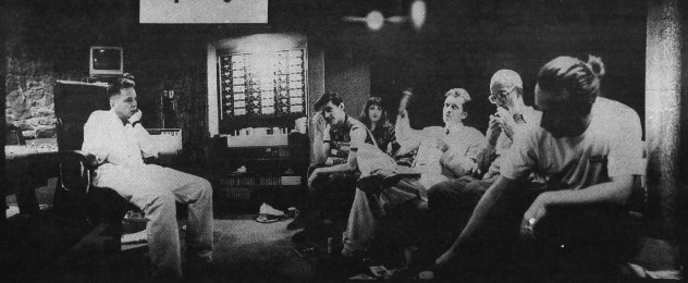 Tony Wilson (waving arms) explains his plan for world domination to New Order...