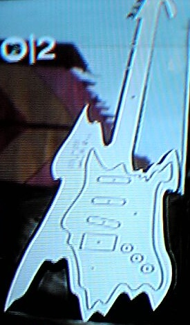 Peter Saville's guitar cut-out giveaway for the UK PSP launch; detail of guitar as featured on Zane Lowe's Gonzo show on MTV2