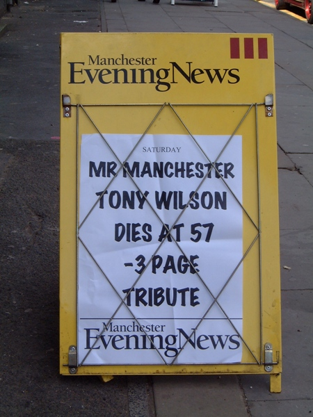 Manchester Evening News street hoarding announcing the death of Tony Wilson