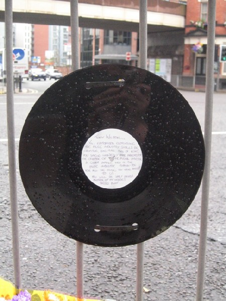12-inch record with handwritten tribute to Tony Wilson, outside the Hacienda Apartments, Manchester